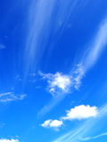 Blue sky windy clouds. Background winddy  heave , fresh air  firmament atmosphere sky sky scape blue sky white cloude Fluffy light hairy sooth Stock Image