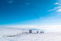 Blue sky winter landscape. Blue sky over snowy hills Royalty Free Stock Photography