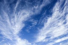 Blue sky with wispy clouds. Stock Photos