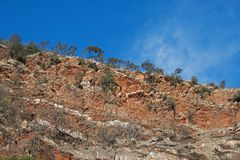 LAYERS OF ROCK ON THE CLIFF FACE OF A HILL royalty free stock images