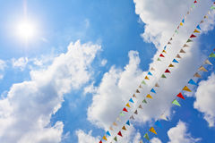 Blue Sky With Multi Colored Party Flags Hanging Royalty Free Stock Image