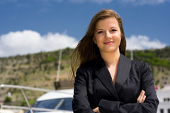 Blue sky and woman near boat Stock Photography