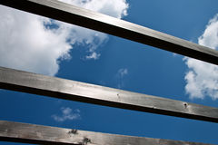 Blue sky through wooden beams. Royalty Free Stock Photo