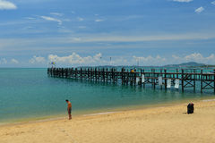 Blue sky and Wooden bridge into the sea. Wooden bridge and pier at koh samui island Royalty Free Stock Photos