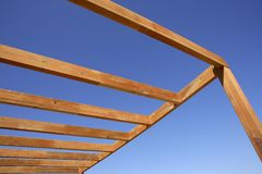 Blue sky wooden golden awning beams Royalty Free Stock Photography