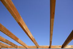 Blue sky wooden golden awning beams Stock Images