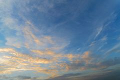 Blue sky with yellow colorful sunset clouds in twilight time.  stock photos