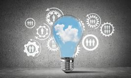 Blue skyscape and clouds inside lightbulb. Stock Photography