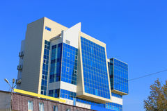 Blue skyscraper. Picture which depicts a small skyscraper with many large blue windows Stock Image