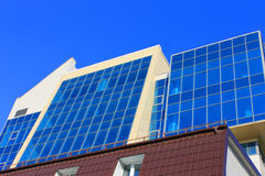 Blue skyscraper. Picture which depicts a small skyscraper with many large blue windows Stock Images