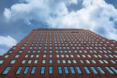 Blue skyscraper windows against a cloudy sky stock photo
