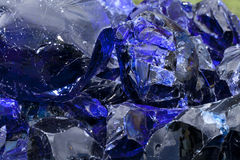 Blue Slag Glass. Blue rock glass (slag glass) used in the glass industry in the manufacturing of color glass. Background color & texture Royalty Free Stock Image