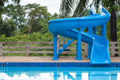 Blue slider on swimming pool Royalty Free Stock Photography