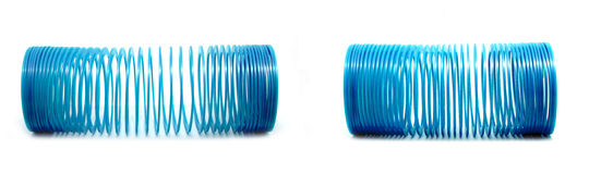 Blue slinky toy. Isolated On White Background Royalty Free Stock Photography