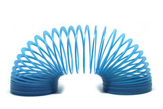 Blue slinky toy. Isolated On White Background Royalty Free Stock Photo