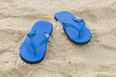 Blue slipper on a sandy beach royalty free stock photography