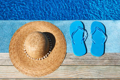 Blue slippers and hat Stock Photography