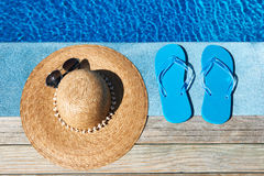 Blue slippers and hat Royalty Free Stock Images