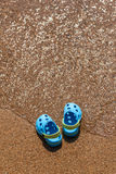 Blue slippers on the sand Stock Photography