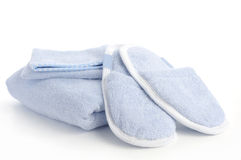 Blue slippers, towel and bath & shower mitt Royalty Free Stock Photos