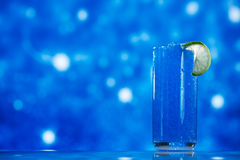 Blue slush ice in glass  on glitter star Royalty Free Stock Images