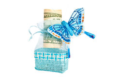Blue small bag with money and butterfly. Isolated on white background Royalty Free Stock Image