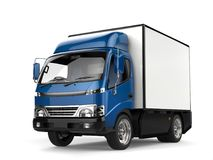 Blue small box truck - closeup shot. Isolated on white background Royalty Free Stock Photo