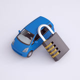 Blue small car and combination lock. 3d render on gray background Royalty Free Stock Image