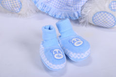 Blue small children's bootees. On a white background Stock Photography