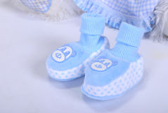 Blue small children's bootees. On a white background Royalty Free Stock Images