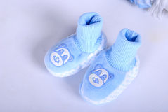 Blue small children's bootees. On a white background Royalty Free Stock Photos