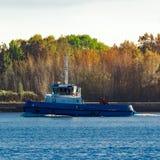 Blue small tug Royalty Free Stock Image