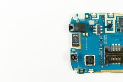 Blue smartphone circuit board showing camera and sim card slot. And electronic elements royalty free stock images