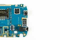 Blue smartphone circuit board showing camera and sim card slot. And electronic elements royalty free stock photos