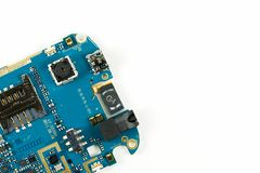 Blue smartphone circuit board showing camera and sim card slot. And electronic elements royalty free stock image