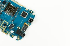 Blue smartphone circuit board showing camera and sim card slot. And electronic elements royalty free stock photo