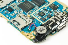 Blue smartphone circuit board showing power cell and sd card slo. T stock photo