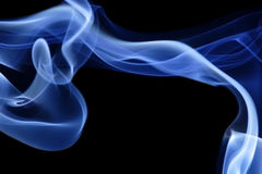 Blue Smoke 10. Abstract curves of blue smoke on a black background Stock Photos