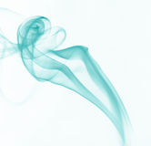 Blue Smoke. With white background Stock Images
