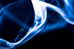 Blue smoke. Abstractly smooth lines of the schedule  flexible easy Stock Photography