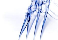 Blue smoke 2. Blue smoke twirl waves over white background Royalty Free Stock Images