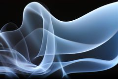 Blue smoke. Abstract smoke wave in blue colour on black  background Royalty Free Stock Photos