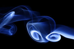 Blue Smoke 4. Abstract curves of blue smoke on a black background Stock Photography