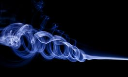 Blue smoke. Close-up of blue tone smoke against black background Royalty Free Stock Photography