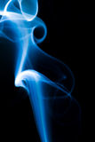 Blue smoke. Abstract curves: blue smoke on black background Royalty Free Stock Photos