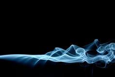 Blue smoke. Spreading horizontally, isolated over black Royalty Free Stock Images