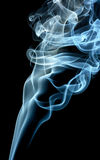 Blue smoke. Column of a gray and blue smoke rising up, isolated over black Royalty Free Stock Photography
