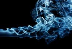 Blue smoke. Puff of a blue smoke spreading horizontally, isolated over black Stock Image