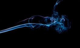 Blue smoke abstract background. Abstract with blue smoke on a black background Royalty Free Stock Photo