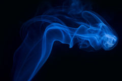 Blue smoke abstract background. With black background royalty free stock images